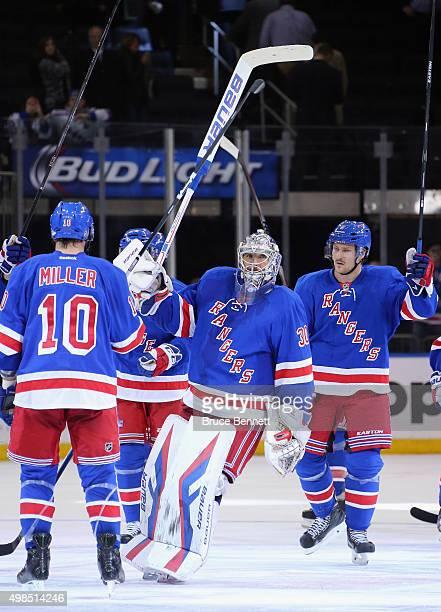 Henrik Lundqvist and the New York Rangers celebrate their 30 shutout over the Nashville Predators at Madison Square Garden on November 23 2015 in New...