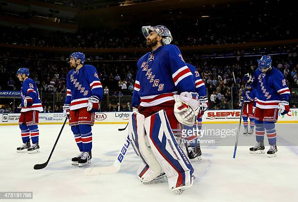 Henrik Lundqvist and the New York Rangers looks on after losing against the Tampa Bay Lightning by a score of 20 in Game Seven of the Eastern...