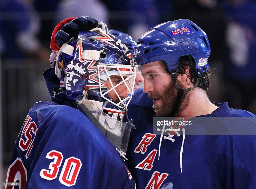 <a gi-track='captionPersonalityLinkClicked' href=/galleries/search?phrase=Henrik+Lundqvist&family=editorial&specificpeople=217958 ng-click='$event.stopPropagation()'>Henrik Lundqvist</a> #30 celebrates their 3 to 0 win over the New Jersey Devils with teammate <a gi-track='captionPersonalityLinkClicked' href=/galleries/search?phrase=Brandon+Prust&family=editorial&specificpeople=2221796 ng-click='$event.stopPropagation()'>Brandon Prust</a> #8 of the New York Rangers in Game One of the Eastern Conference Final during the 2012 NHL Stanley Cup Playoffs at Madison Square Garden on May 14, 2012 in New York City.