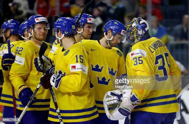 Henrik Lundqvist goaltender of Sweden celebrate victory with his team mates after the 2017 IIHF Ice Hockey World Championship semi final game between...