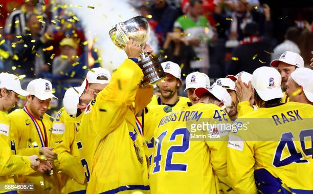 Henrik Lundqvist goaltender of Sweden lifts the trophy after the 2017 IIHF Ice Hockey World Championship Gold Medal game Canada and Sweden at Lanxess...