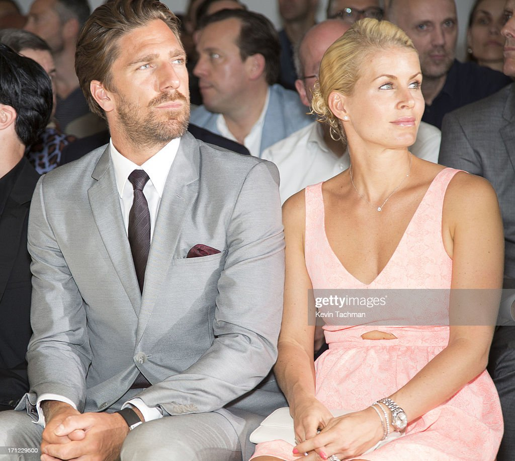Henrik Lundqvist, left, and Therese Andersson attend the Calvin Klein Collection show during Milan Menswear Fashion Week Spring Summer 2014 on June 23, 2013 in Milan, Italy.
