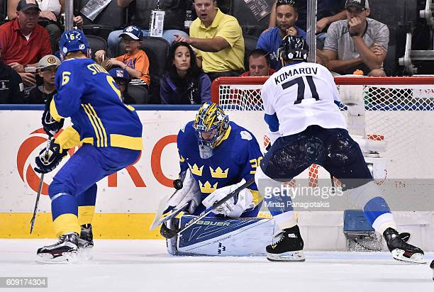 Henrik Lundqvist makes a save with Anton Stralman of Team Sweden and Leo Komarov of Team Finland in front during the World Cup of Hockey 2016 at Air...