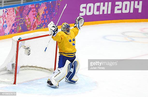 Henrik Lundqvist of Sweden celebrates after defeating Finland 21 during the Men's Ice Hockey Semifinal Playoff on Day Twelve of the 2014 Sochi Winter...