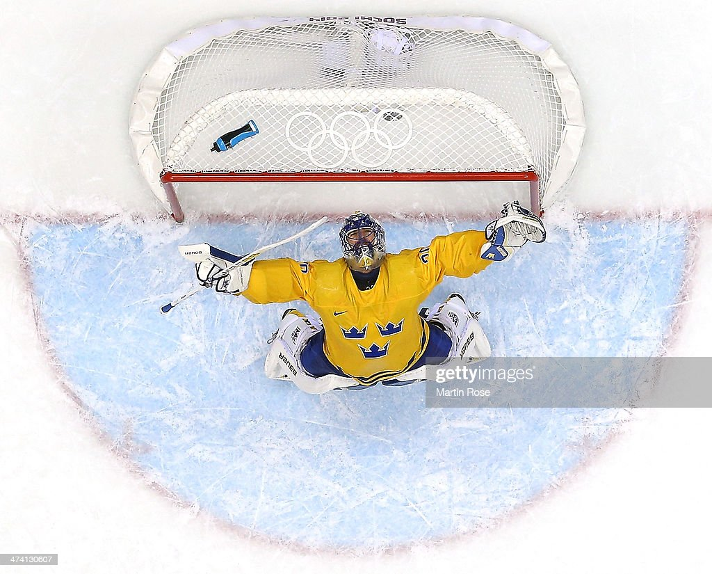 <a gi-track='captionPersonalityLinkClicked' href=/galleries/search?phrase=Henrik+Lundqvist&family=editorial&specificpeople=217958 ng-click='$event.stopPropagation()'>Henrik Lundqvist</a> #30 of Sweden celebrates after defeating Finland 2-1 during the Men's Ice Hockey Semifinal Playoff on Day 14 of the 2014 Sochi Winter Olympics at Bolshoy Ice Dome on February 21, 2014 in Sochi, Russia.