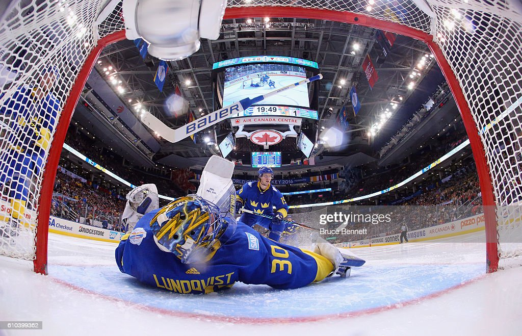 Henrik Lundqvist #30 of Team Sweden loses his stick during a goal by Tomas Tatar #21 of Team Europe during the third period at the semifinal game during the World Cup of Hockey tournament at the Air Canada Centre on September 25, 2016 in Toronto, Canada.