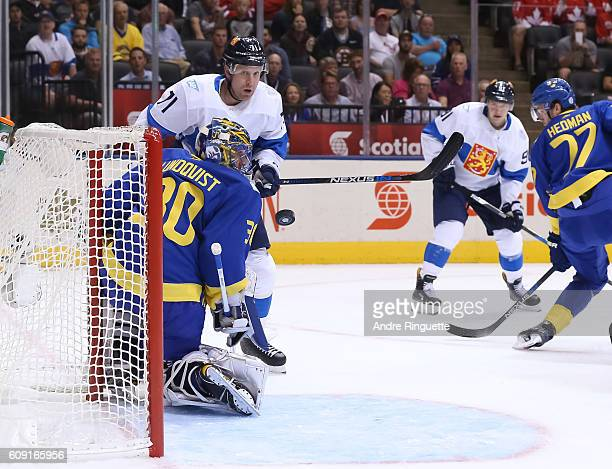 Henrik Lundqvist of Team Sweden makes a save with Leo Komarov of Team Finland in front during the World Cup of Hockey 2016 at Air Canada Centre on...