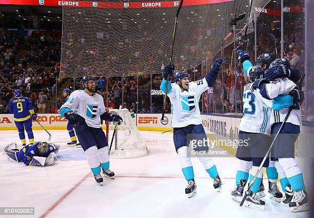 Henrik Lundqvist of Team Sweden reacts as Tomas Tatar of Team Europe is congratulated by his teammates after scoring the game winning goal in...