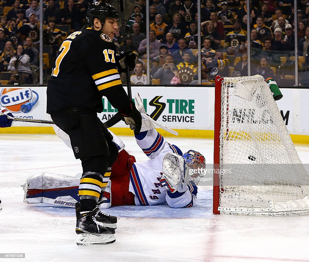 Henrik Lundqvist of the New York Rangers allows a goal by Milan Lucic of the Boston Bruins in the first period at the TD Garden on March 28 2015 in...