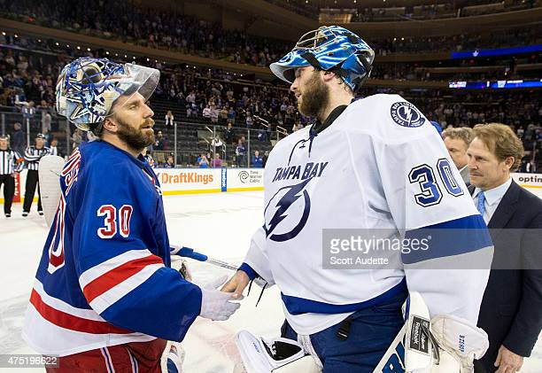 Henrik Lundqvist of the New York Rangers and Ben Bishop of the Tampa Bay Lightning shake hands after the Tampa Bay Lightning defeated the New York...