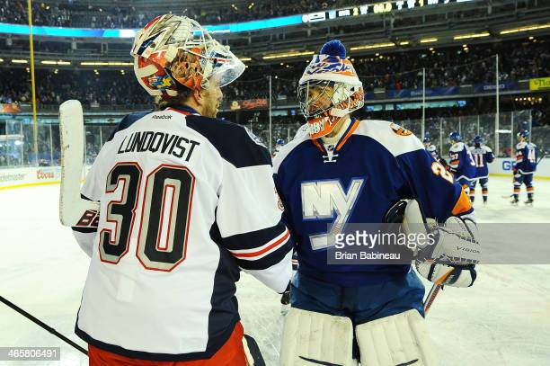 Henrik Lundqvist of the New York Rangers and Evgeni Nabokov of the New York Islanders shake hands after the 2014 Coors Light NHL Stadium Series at...