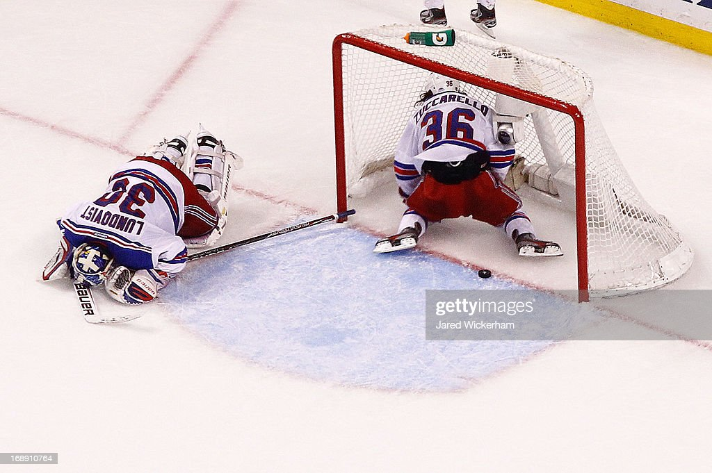 <a gi-track='captionPersonalityLinkClicked' href=/galleries/search?phrase=Henrik+Lundqvist&family=editorial&specificpeople=217958 ng-click='$event.stopPropagation()'>Henrik Lundqvist</a> #30 of the New York Rangers and <a gi-track='captionPersonalityLinkClicked' href=/galleries/search?phrase=Mats+Zuccarello&family=editorial&specificpeople=7219903 ng-click='$event.stopPropagation()'>Mats Zuccarello</a> #36 of the New York Rangers lie on the ice after giving up the game-winning overtime goal by Brad Marchand (not pictured) of the Boston Bruins in Game One of the Eastern Conference Semifinals during the 2013 NHL Stanley Cup Playoffs on May 16, 2013 at TD Garden in Boston, Massachusetts.