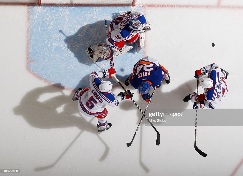 <a gi-track='captionPersonalityLinkClicked' href=/galleries/search?phrase=Henrik+Lundqvist&family=editorial&specificpeople=217958 ng-click='$event.stopPropagation()'>Henrik Lundqvist</a> #30 of the New York Rangers and teammates <a gi-track='captionPersonalityLinkClicked' href=/galleries/search?phrase=Michael+Del+Zotto&family=editorial&specificpeople=4044191 ng-click='$event.stopPropagation()'>Michael Del Zotto</a> #4 and Dan Girardi #5 protect the net as <a gi-track='captionPersonalityLinkClicked' href=/galleries/search?phrase=Brad+Boyes&family=editorial&specificpeople=275014 ng-click='$event.stopPropagation()'>Brad Boyes</a> #24 of the New York Islanders pursues the puck at Nassau Veterans Memorial Coliseum on April 13, 2013 in Uniondale, New York. The Rangers defeated the Islanders 1-0.