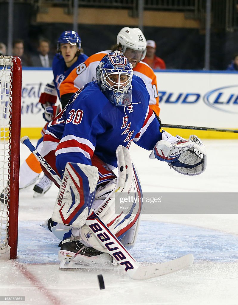 <a gi-track='captionPersonalityLinkClicked' href=/galleries/search?phrase=Henrik+Lundqvist&family=editorial&specificpeople=217958 ng-click='$event.stopPropagation()'>Henrik Lundqvist</a> #30 of the New York Rangers blocks a shot in the third period against the Philadelphia Flyers on March 5, 2013 at Madison Square Garden in New York City.The New York Rangers defeated the Philadelphia Flyers 4-2.