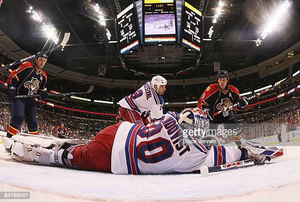 Henrik Lundqvist of the New York Rangers blocks the net against Stephen Weiss of the Florida Panthers on February 13 2009 at the BankAtlantic Center...