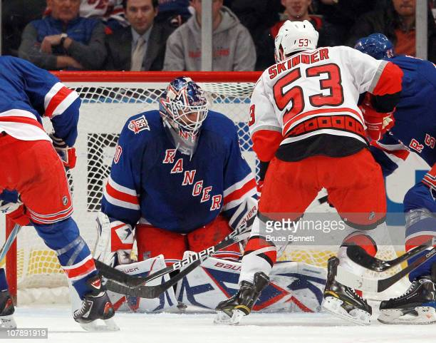 Henrik Lundqvist of the New York Rangers blocks the net as Jeff Skinner of the Carolina Hurricanes looks for a rebound at Madison Square Garden on...