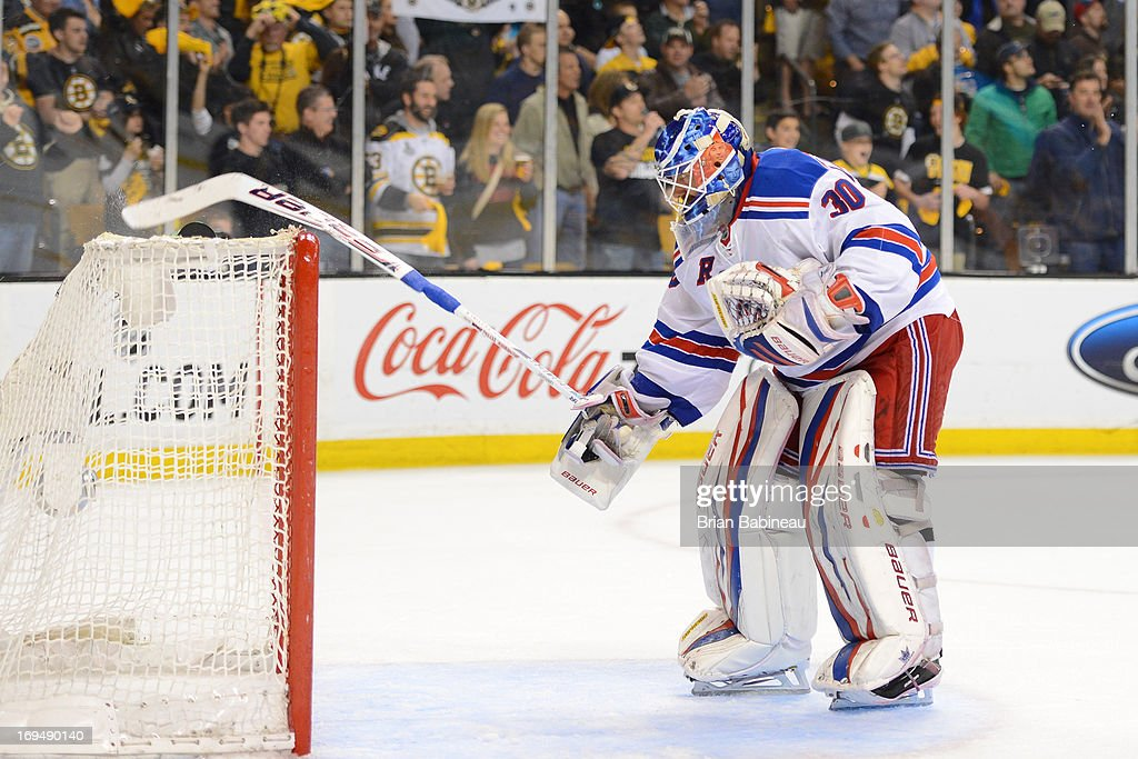<a gi-track='captionPersonalityLinkClicked' href=/galleries/search?phrase=Henrik+Lundqvist&family=editorial&specificpeople=217958 ng-click='$event.stopPropagation()'>Henrik Lundqvist</a> #30 of the New York Rangers breaks his stick on the net after the goal from the Boston Bruins in Game Five of the Eastern Conference Semifinals during the 2013 NHL Stanley Cup Playoffs at TD Garden on May 25, 2013 in Boston, Massachusetts.