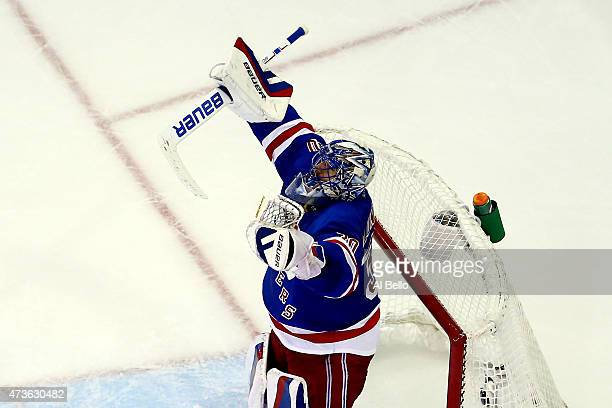 Henrik Lundqvist of the New York Rangers celebrates after defeating the Tampa Bay Lightning 21 in Game One of the Eastern Conference Finals during...