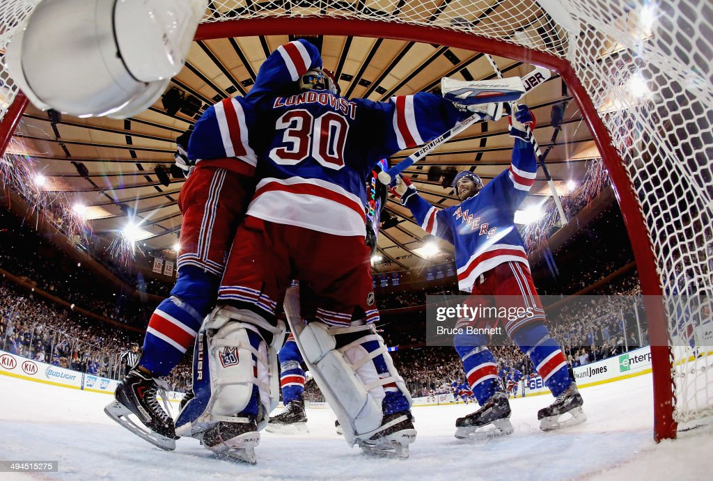 <a gi-track='captionPersonalityLinkClicked' href=/galleries/search?phrase=Henrik+Lundqvist&family=editorial&specificpeople=217958 ng-click='$event.stopPropagation()'>Henrik Lundqvist</a> #30 of the New York Rangers celebrates after defeating the Montreal Canadiens in Game Six to win the Eastern Conference Final in the 2014 NHL Stanley Cup Playoffs at Madison Square Garden on May 29, 2014 in New York City. The New York Rangers defeated the Montreal Canadiens 1 to 0.