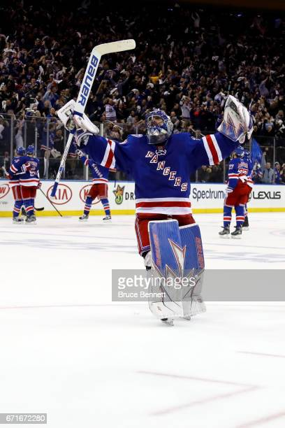Henrik Lundqvist of the New York Rangers celebrates teammate Derek Stepan empty net goal against the Montreal Canadiens during the third period in...