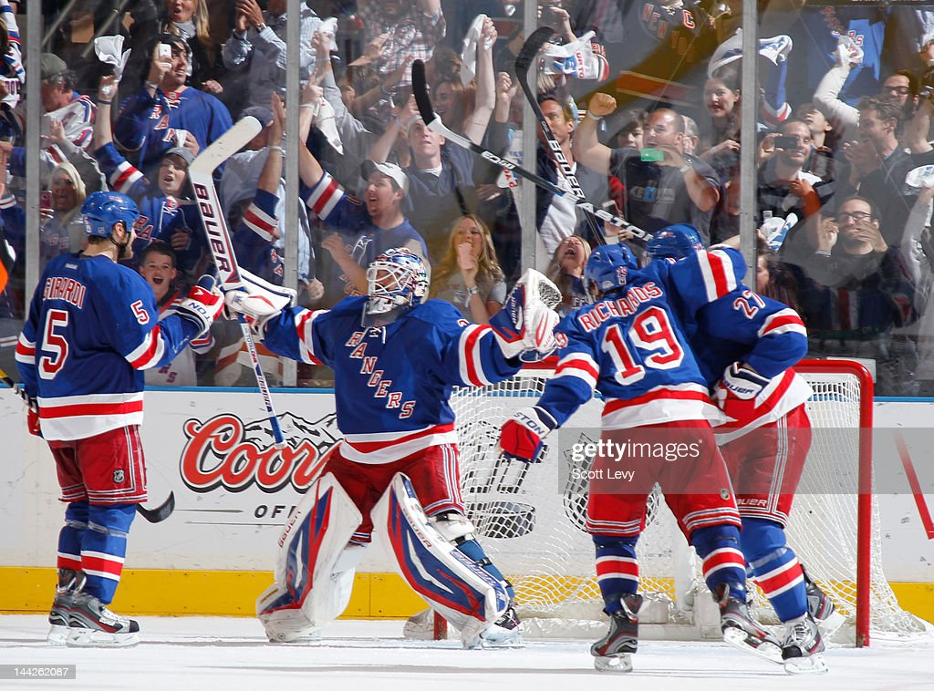 Henrik Lundqvist #30 of the New York Rangers celebrates the win against the Washington Capitals in Game Seven of the Eastern Conference Semifinals during the 2012 NHL Stanley Cup Playoffs at Madison Square Garden on May 12, 2012 in New York City. The Rangers defeat the Capitals 2-1.