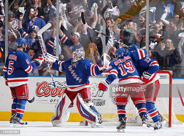 Henrik Lundqvist of the New York Rangers celebrates the win against the Washington Capitals in Game Seven of the Eastern Conference Semifinals during...