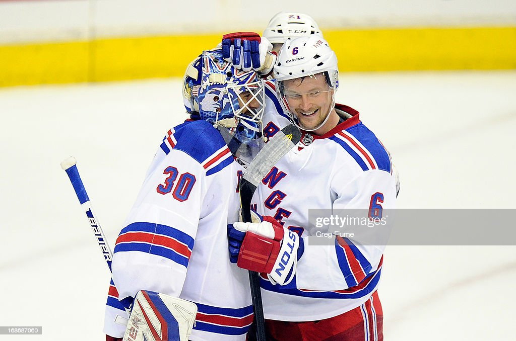 <a gi-track='captionPersonalityLinkClicked' href=/galleries/search?phrase=Henrik+Lundqvist&family=editorial&specificpeople=217958 ng-click='$event.stopPropagation()'>Henrik Lundqvist</a> #30 of the New York Rangers celebrates with <a gi-track='captionPersonalityLinkClicked' href=/galleries/search?phrase=Anton+Stralman&family=editorial&specificpeople=2271901 ng-click='$event.stopPropagation()'>Anton Stralman</a> #6 after a 5-0 victory against the Washington Capitals in Game Seven of the Eastern Conference Quarterfinals during the 2013 NHL Stanley Cup Playoffs at the Verizon Center on May 13, 2013 in Washington, DC.
