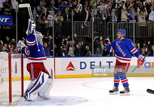 Henrik Lundqvist of the New York Rangers celebrates with his teammate Ryan McDonagh after defeating the Montreal Canadiens in Game Six to win the...