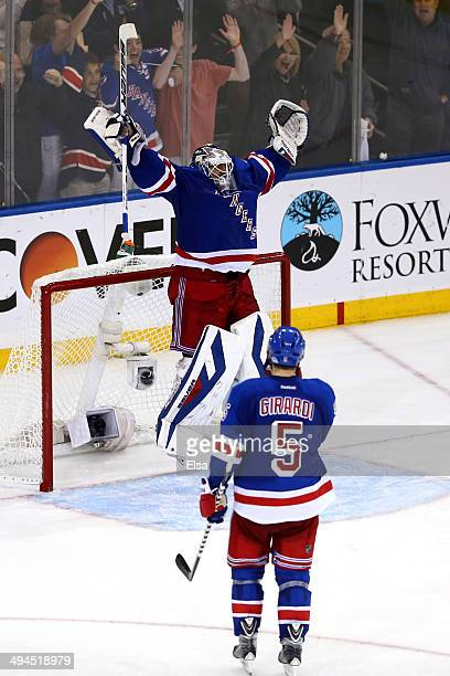 Henrik Lundqvist of the New York Rangers celebrates with teammate Dan Girardi after defeating the Montreal Canadiens in Game Six to win the Eastern...