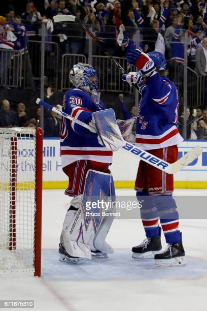 Henrik Lundqvist of the New York Rangers celebrates with teammate Marc Staal after defeating the Montreal Canadiens in Game Six of the Eastern...