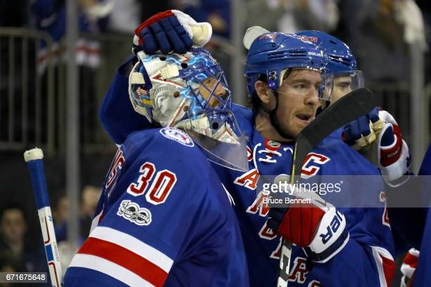 Henrik Lundqvist of the New York Rangers celebrates with teammate Ryan McDonagh after defeating the Montreal Canadiens in Game Six of the Eastern...