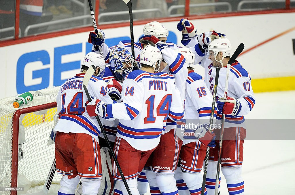 <a gi-track='captionPersonalityLinkClicked' href=/galleries/search?phrase=Henrik+Lundqvist&family=editorial&specificpeople=217958 ng-click='$event.stopPropagation()'>Henrik Lundqvist</a> #30 of the New York Rangers celebrates with teammates after a 5-0 victory against the Washington Capitals in Game Seven of the Eastern Conference Quarterfinals during the 2013 NHL Stanley Cup Playoffs at the Verizon Center on May 13, 2013 in Washington, DC.