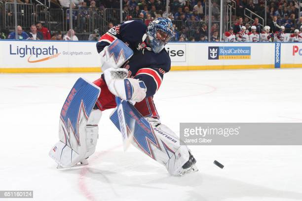 Henrik Lundqvist of the New York Rangers clears the puck against the Montreal Canadiens at Madison Square Garden on March 4 2017 in New York City The...