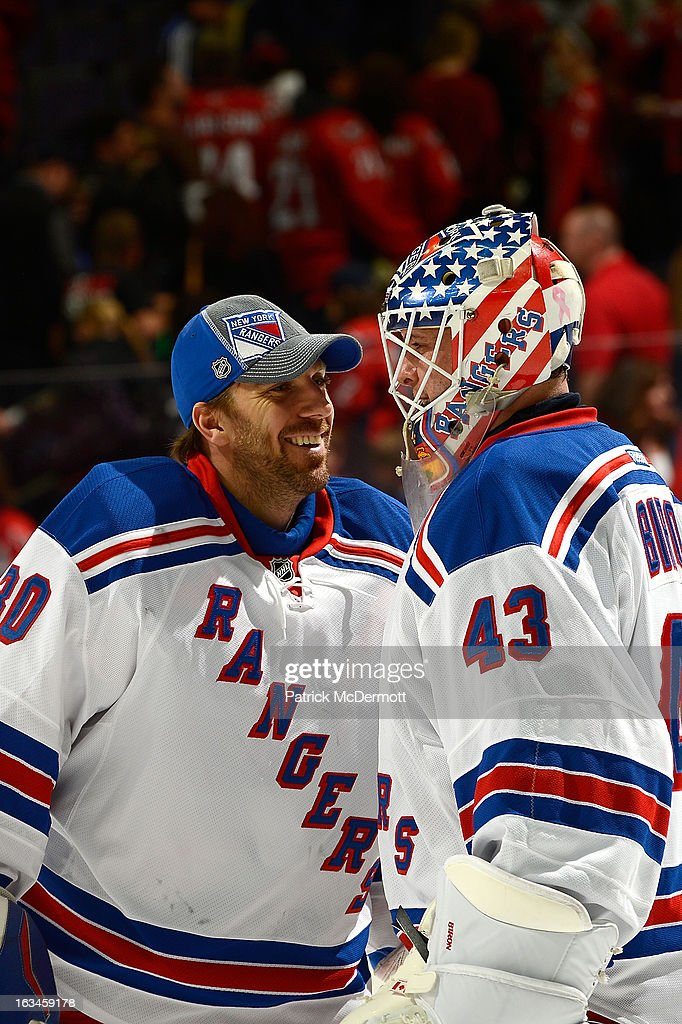 <a gi-track='captionPersonalityLinkClicked' href=/galleries/search?phrase=Henrik+Lundqvist&family=editorial&specificpeople=217958 ng-click='$event.stopPropagation()'>Henrik Lundqvist</a> #30 of the New York Rangers (Left) congratulates <a gi-track='captionPersonalityLinkClicked' href=/galleries/search?phrase=Martin+Biron&family=editorial&specificpeople=203146 ng-click='$event.stopPropagation()'>Martin Biron</a> #43 (Right) after an NHL game against the Washington Capitals at Verizon Center on March 10, 2013 in Washington, DC.