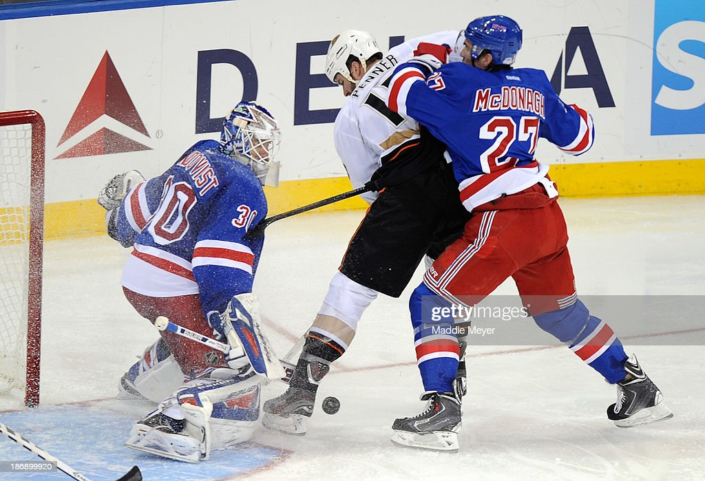 <a gi-track='captionPersonalityLinkClicked' href=/galleries/search?phrase=Henrik+Lundqvist&family=editorial&specificpeople=217958 ng-click='$event.stopPropagation()'>Henrik Lundqvist</a> #30 of the New York Rangers defends a shot from <a gi-track='captionPersonalityLinkClicked' href=/galleries/search?phrase=Dustin+Penner&family=editorial&specificpeople=589919 ng-click='$event.stopPropagation()'>Dustin Penner</a> #17 of the Anaheim Ducks with pressure from <a gi-track='captionPersonalityLinkClicked' href=/galleries/search?phrase=Ryan+McDonagh&family=editorial&specificpeople=4324983 ng-click='$event.stopPropagation()'>Ryan McDonagh</a> #27 of the New York Rangers during the third period at Madison Square Garden on November 4, 2013 in New York City. The Ducks defeat the Rangers 2-1.