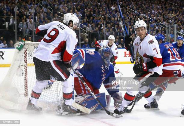 Henrik Lundqvist of the New York Rangers defends against Bobby Ryan and Kyle Turris of the Ottawa Senators in Game Three of the Eastern Conference...