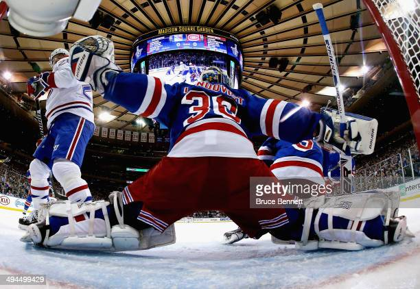 Henrik Lundqvist of the New York Rangers defends the net against the Montreal Canadiens during Game Six of the Eastern Conference Final in the 2014...
