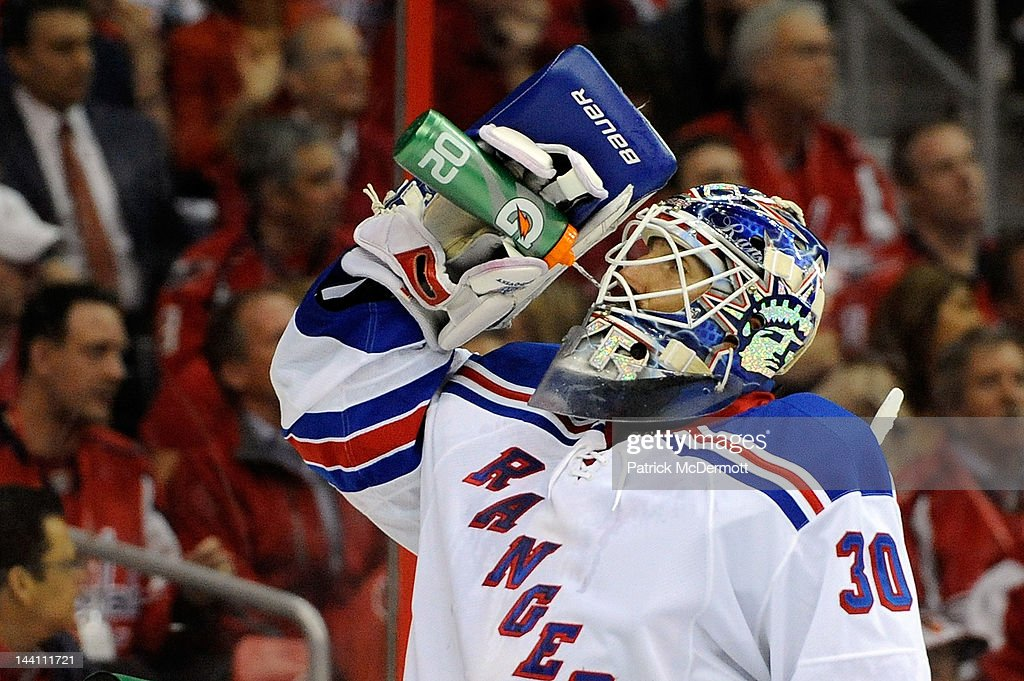 <a gi-track='captionPersonalityLinkClicked' href=/galleries/search?phrase=Henrik+Lundqvist&family=editorial&specificpeople=217958 ng-click='$event.stopPropagation()'>Henrik Lundqvist</a> #30 of the New York Rangers drinks water during a stop in play against the Washington Capitals in Game Six of the Eastern Conference Semifinals during the 2012 NHL Stanley Cup Playoffs at Verizon Center on May 9, 2012 in Washington, DC.