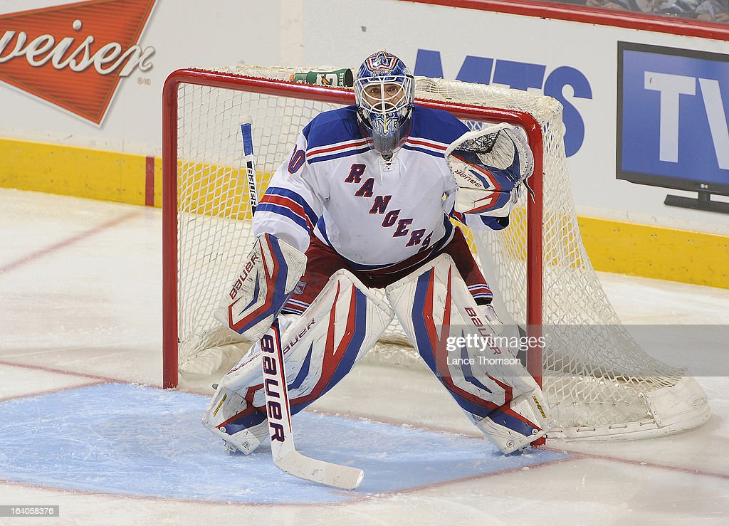 <a gi-track='captionPersonalityLinkClicked' href=/galleries/search?phrase=Henrik+Lundqvist&family=editorial&specificpeople=217958 ng-click='$event.stopPropagation()'>Henrik Lundqvist</a> #30 of the New York Rangers gets set in the crease during second period action against the Winnipeg Jets at the MTS Centre on March 14, 2013 in Winnipeg, Manitoba, Canada. The Jets defeated the Rangers 3-1.