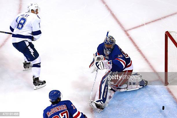 Henrik Lundqvist of the New York Rangers gives up a goal to Ondrej Palat of the Tampa Bay Lightning during the third period in Game Seven of the...