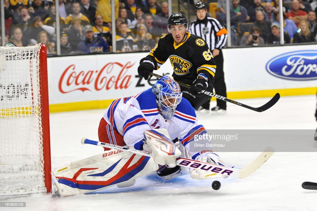 Henrik Lundqvist #30 of the New York Rangers grabs the loose puck against the Boston Bruins at the TD Garden on February 12, 2013 in Boston, Massachusetts.