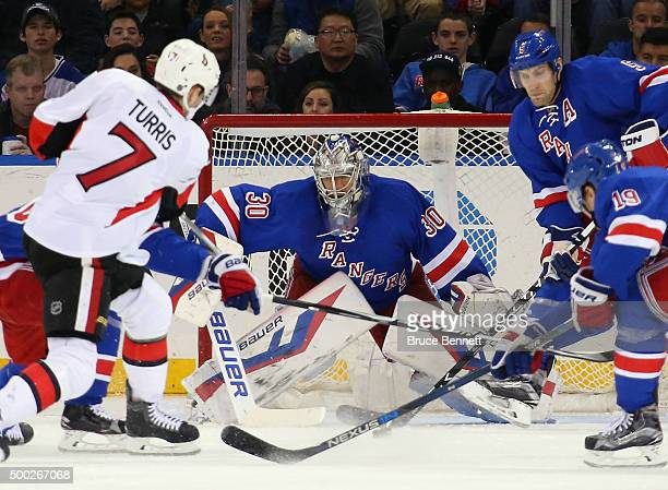 Henrik Lundqvist of the New York Rangers guards the net against the Ottawa Senators during the second period at Madison Square Garden on December 6...