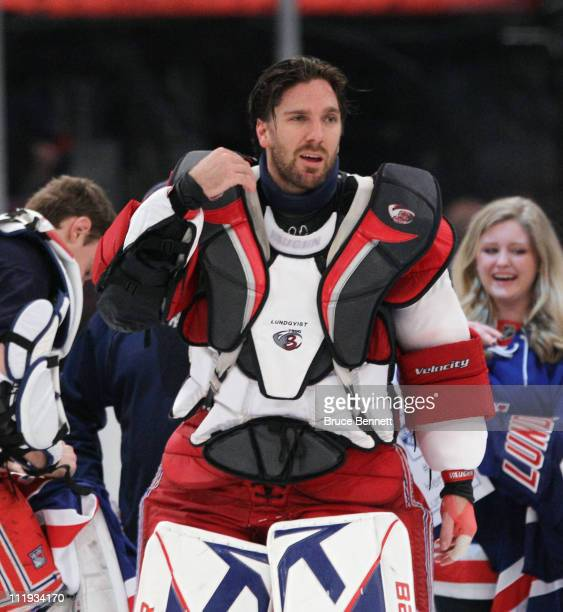 Henrik Lundqvist of the New York Rangers heads to the lockerroom following the Rangers 52 victory over the New Jersey Devils at Madison Square Garden...