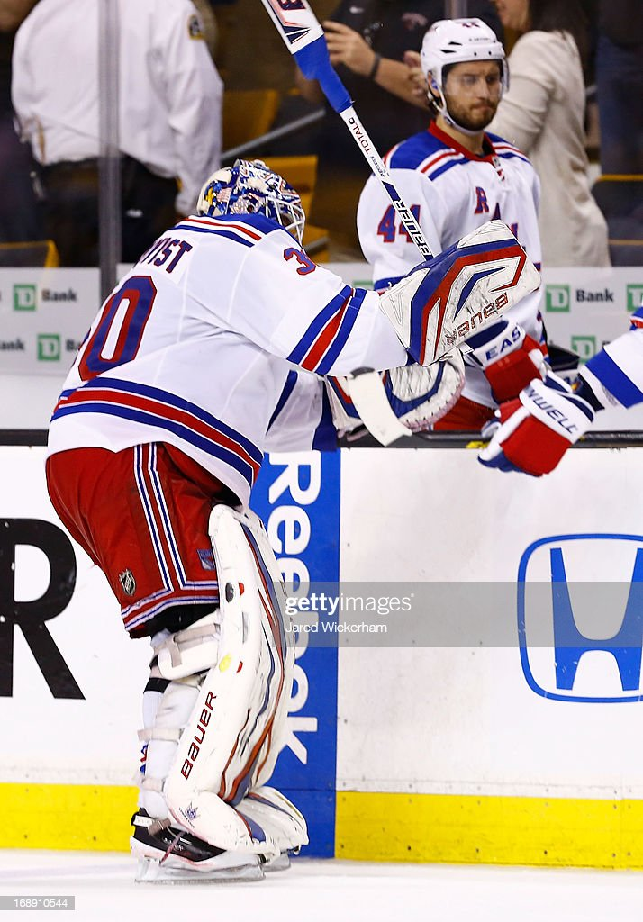 <a gi-track='captionPersonalityLinkClicked' href=/galleries/search?phrase=Henrik+Lundqvist&family=editorial&specificpeople=217958 ng-click='$event.stopPropagation()'>Henrik Lundqvist</a> #30 of the New York Rangers hits his stick against the boards following a 3-2 overtime loss against the Boston Bruins in Game One of the Eastern Conference Semifinals during the 2013 NHL Stanley Cup Playoffs on May 16, 2013 at TD Garden in Boston, Massachusetts.