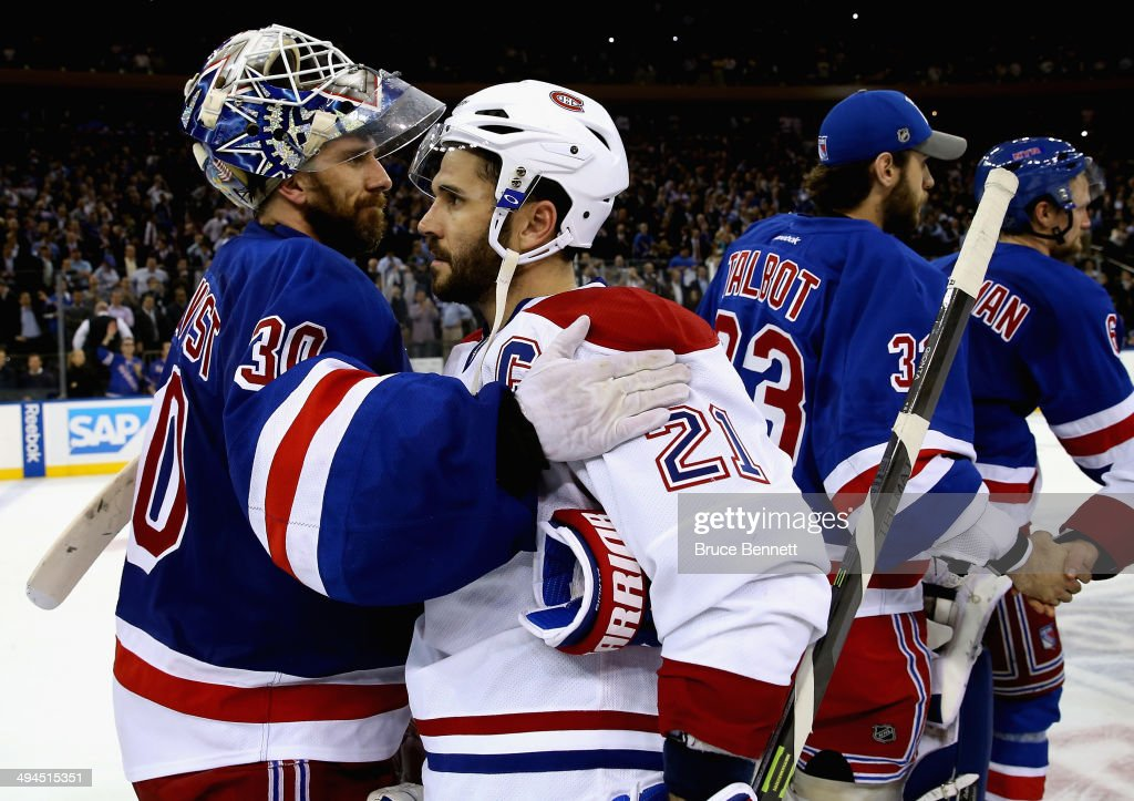 <a gi-track='captionPersonalityLinkClicked' href=/galleries/search?phrase=Henrik+Lundqvist&family=editorial&specificpeople=217958 ng-click='$event.stopPropagation()'>Henrik Lundqvist</a> #30 of the New York Rangers hugs <a gi-track='captionPersonalityLinkClicked' href=/galleries/search?phrase=Brian+Gionta&family=editorial&specificpeople=202116 ng-click='$event.stopPropagation()'>Brian Gionta</a> #21 of the Montreal Canadiens after winning Game Six of the Eastern Conference Final in the 2014 NHL Stanley Cup Playoffs at Madison Square Garden on May 29, 2014 in New York City. The New York Rangers defeated the Montreal Canadiens 1 to 0.