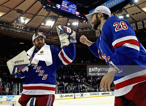 Henrik Lundqvist of the New York Rangers hugs teammate Dominic Moore after defeating the Montreal Canadiens in Game Six to win the Eastern Conference...