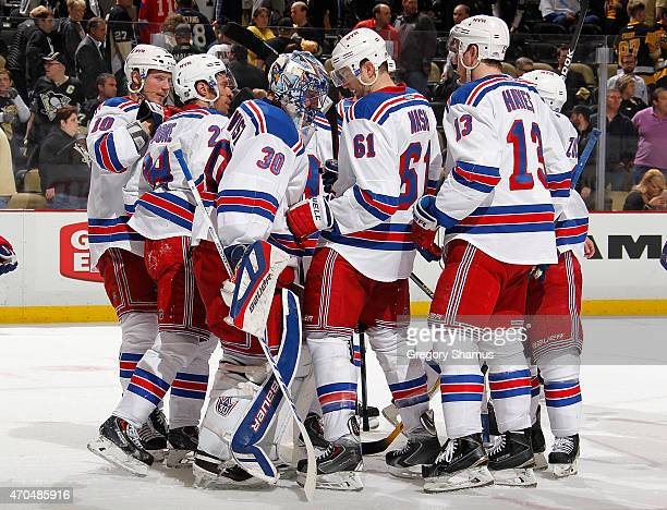 Henrik Lundqvist of the New York Rangers is congratulated by teammates after a 21 win over the Pittsburgh Penguins in Game Three of the Eastern...