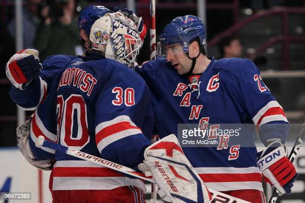 Henrik Lundqvist of the New York Rangers is congratulated by team mate Chris Drury after defeating the New Jersey Devils during their game on...