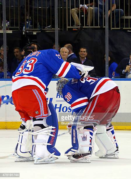 Henrik Lundqvist of the New York Rangers is consoled by teammate Cam Talbot after losing against the Tampa Bay Lightning by a score of 20 in Game...