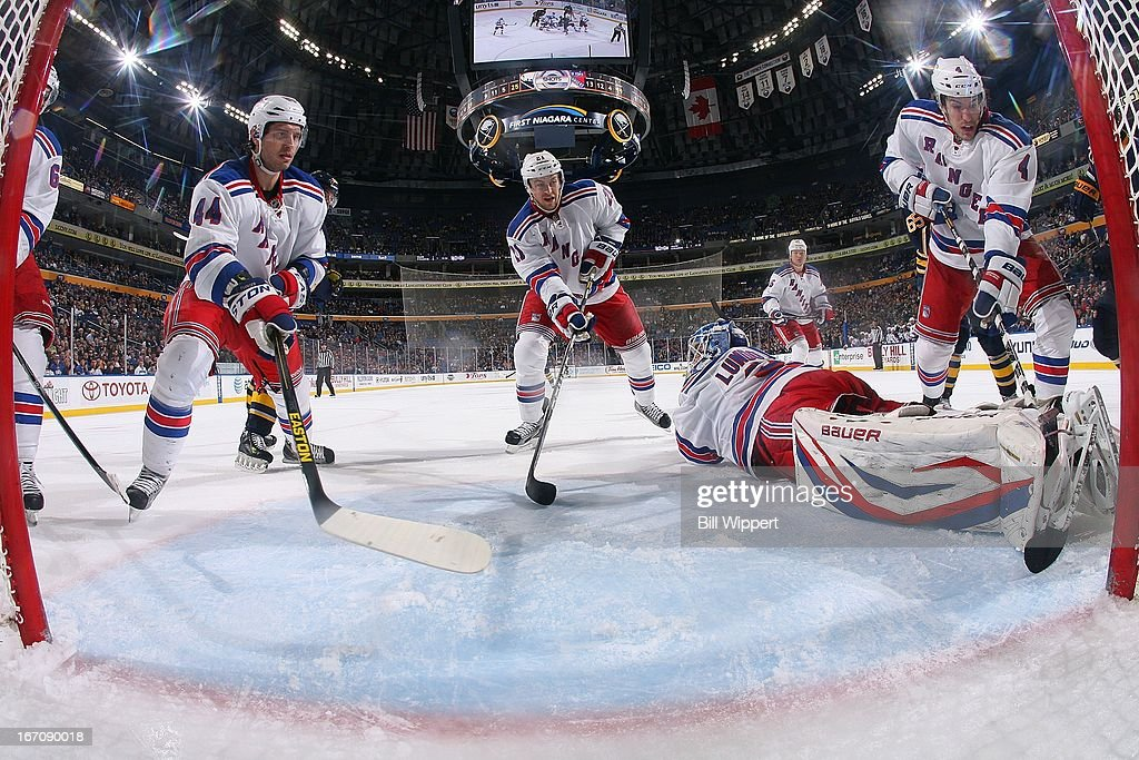 <a gi-track='captionPersonalityLinkClicked' href=/galleries/search?phrase=Henrik+Lundqvist&family=editorial&specificpeople=217958 ng-click='$event.stopPropagation()'>Henrik Lundqvist</a> #30 of the New York Rangers is joined by all five teammates as he makes a third period during their 8-4 victory against the Buffalo Sabres on April 19, 2013 at the First Niagara Center in Buffalo, New York. Defending (L-R) are <a gi-track='captionPersonalityLinkClicked' href=/galleries/search?phrase=Anton+Stralman&family=editorial&specificpeople=2271901 ng-click='$event.stopPropagation()'>Anton Stralman</a> #6, <a gi-track='captionPersonalityLinkClicked' href=/galleries/search?phrase=Steve+Eminger&family=editorial&specificpeople=221303 ng-click='$event.stopPropagation()'>Steve Eminger</a> #44, <a gi-track='captionPersonalityLinkClicked' href=/galleries/search?phrase=Derek+Stepan&family=editorial&specificpeople=4687181 ng-click='$event.stopPropagation()'>Derek Stepan</a> #21, Arron Ashman #45 and <a gi-track='captionPersonalityLinkClicked' href=/galleries/search?phrase=Michael+Del+Zotto&family=editorial&specificpeople=4044191 ng-click='$event.stopPropagation()'>Michael Del Zotto</a> #4.
